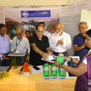 16.Dr_._Rajendra_Jagdale_Director_General__CEO_Science_and_Technology_Park_Pune_distributing_Solar_LED_Homelights-w1000-h1000